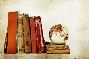 Plie of old books with globe